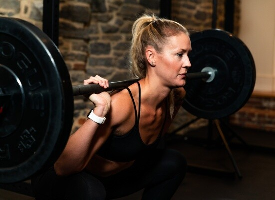 Fitness coach lifting weights