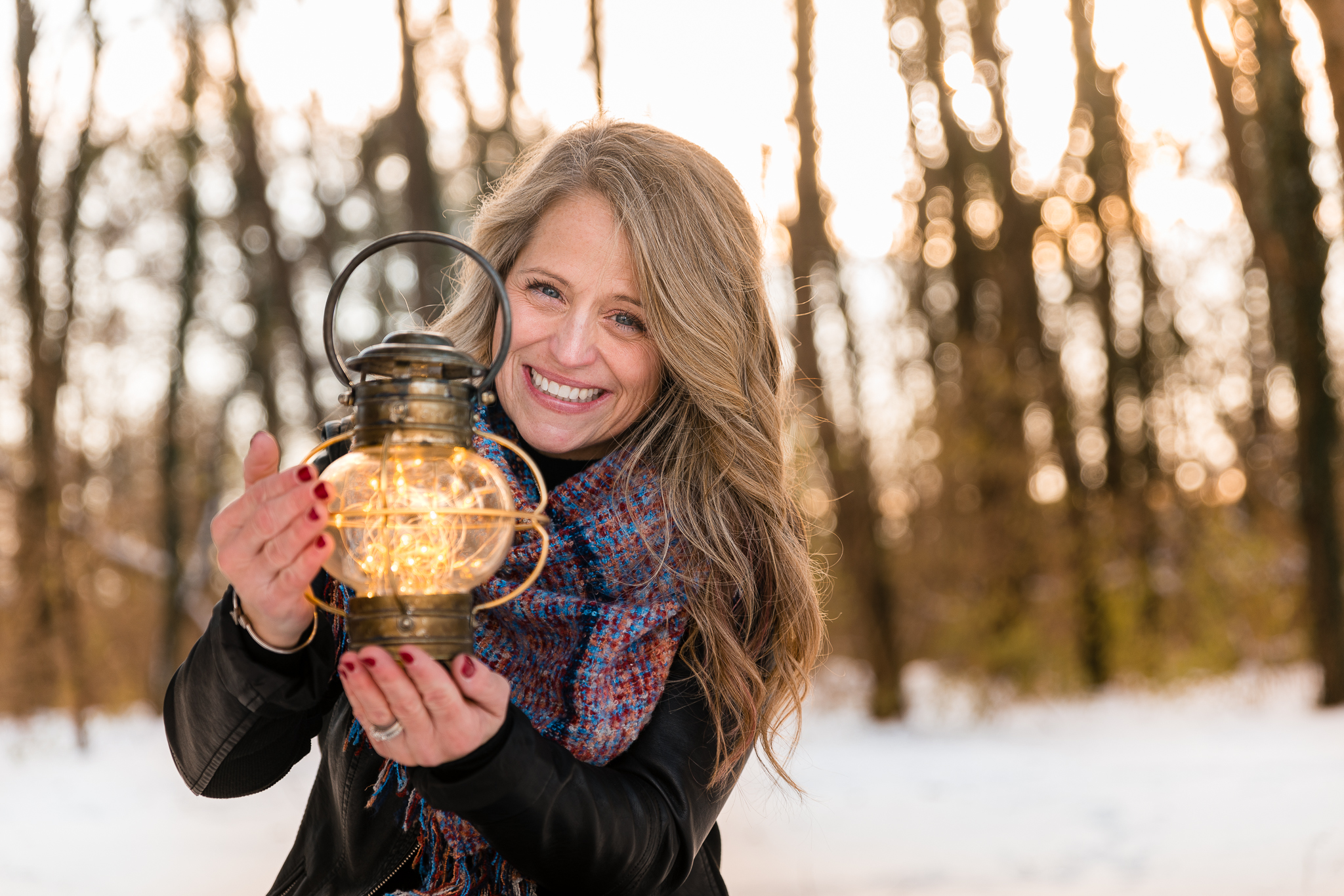 Envision Train owner Theresa Fackler at Overland Park in Lancaster shining fairy lights