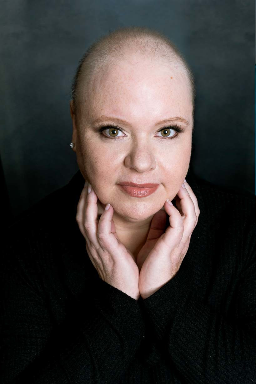 bold, bald, powerful portrait of female cancer patient